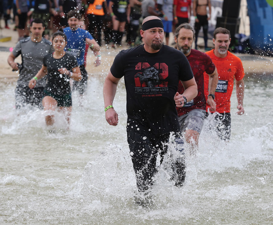 Jeremy Farris runs through Lake Lanier to start the BattleFrog Obstacle Race Series at Lanier Islands in Buford.