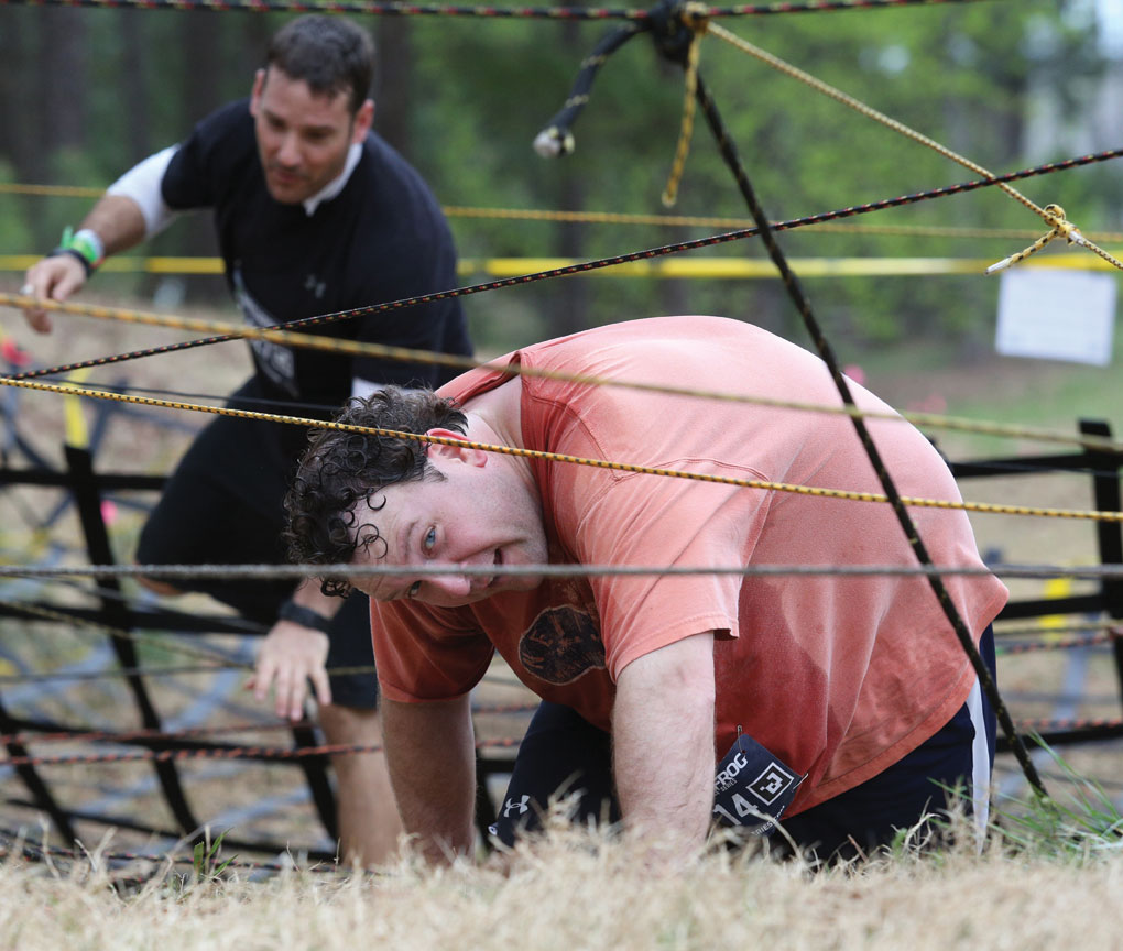 Tres Carpenter navigates his way through a rope obstacle.