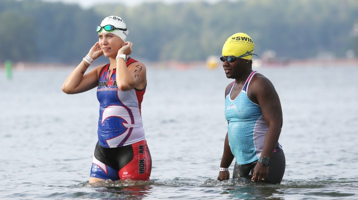 Nadya Dhadiala and Marie Ducheine chat as they wade in Lake Lanier before their race.