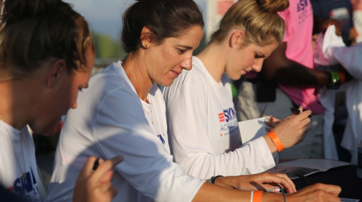Olympians Kristy Kowal and Missy Franklin sign autographs during Swim Across America.