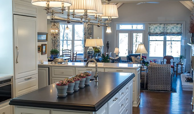 The Wilheit kitchen features vaulted ceilings with exposed beams. There is also a hole in an upper wall the architect added to help air flow.
